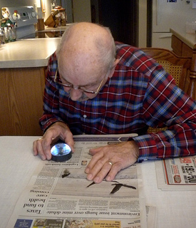 Turn your newspaper into a large print newspaper with a dome reading magnifier