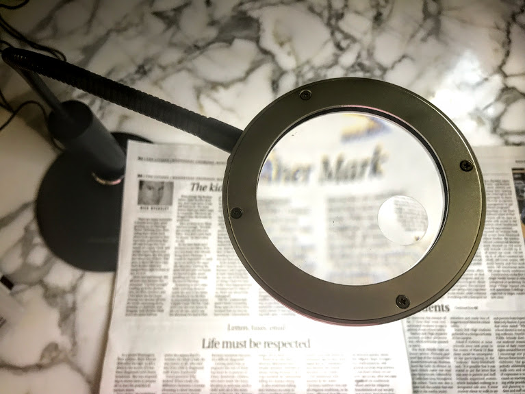 a magnifying desk lamp - a macular degeneration aid to turn your printed material into large print newspapers