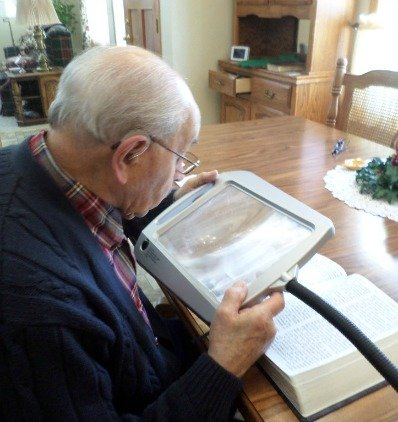 combine large print books with lighted magnifier