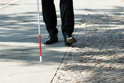 white cane for the blind and those with low vision